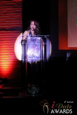 Carmelia Ray announcing Best Up and Coming Dating Site at the 2013 Las Vegas iDate Awards Ceremony